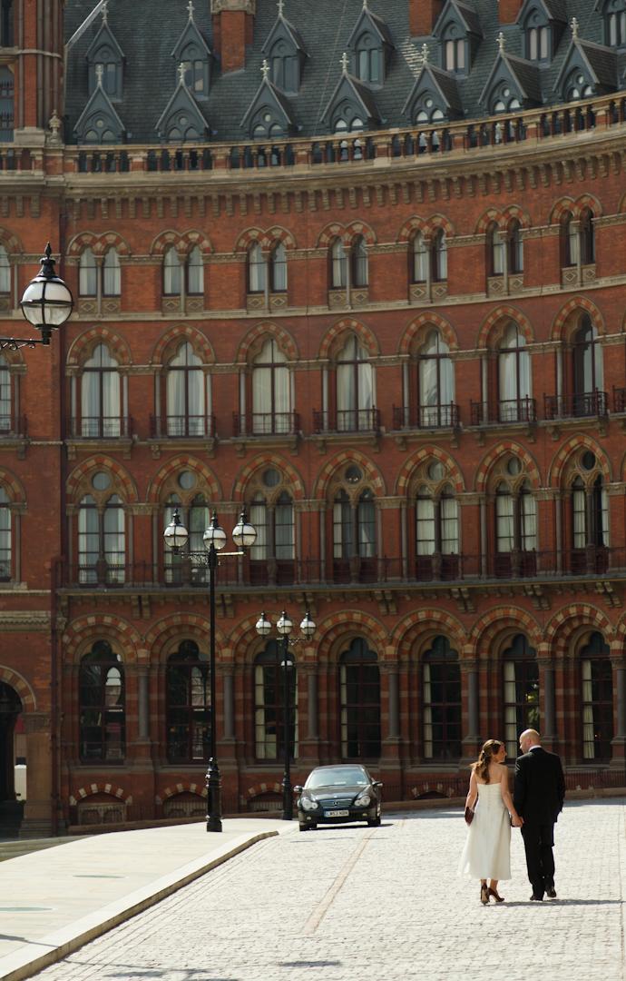 Bride and Groom walk towards their honeymoon hotel