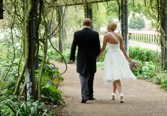 Bride and Groom walk in the park after their Lanesborough Hotel wedding