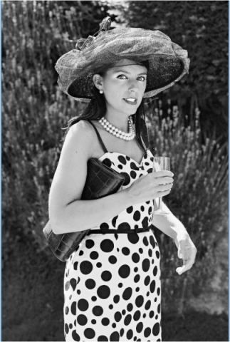 Stylish wedding guest photographed on black and white film