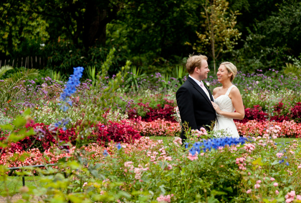 Bride and groom talk a walk in the gardens at Hyde Park in Mayfair, London.