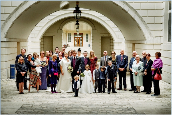 A large family wedding photograph at The Queen's House in Greenwich