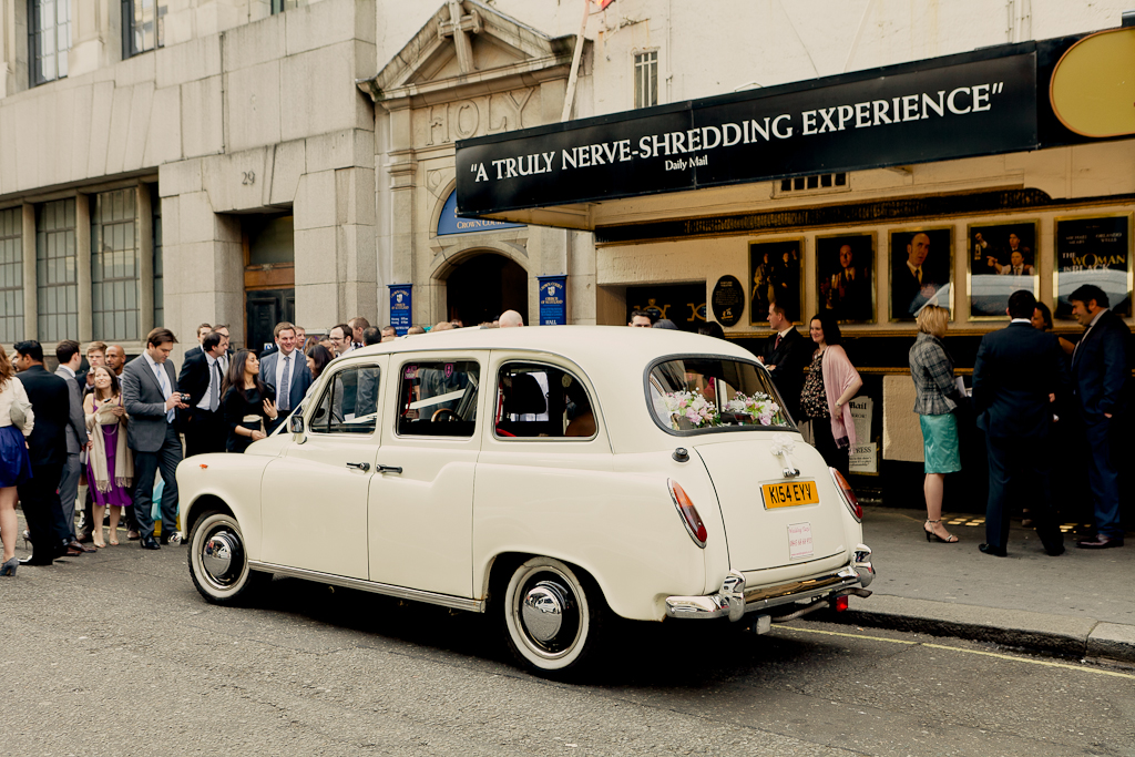 London Wedding Taxi arrives with the bride on board in Covent Garden