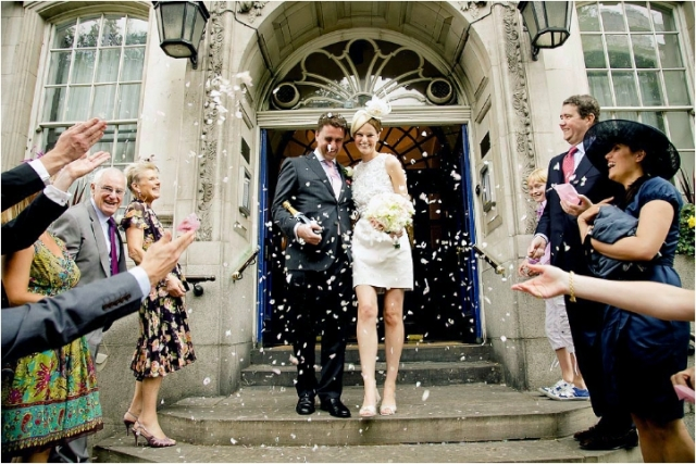 Bride and Groom walk through confetti at Chelsea Town Hall