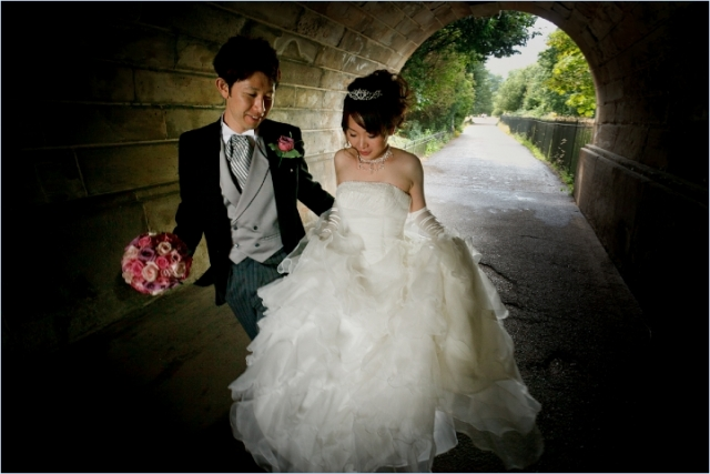 Japanese Bride and Groom walk through the tunnel of love in Hyde Park